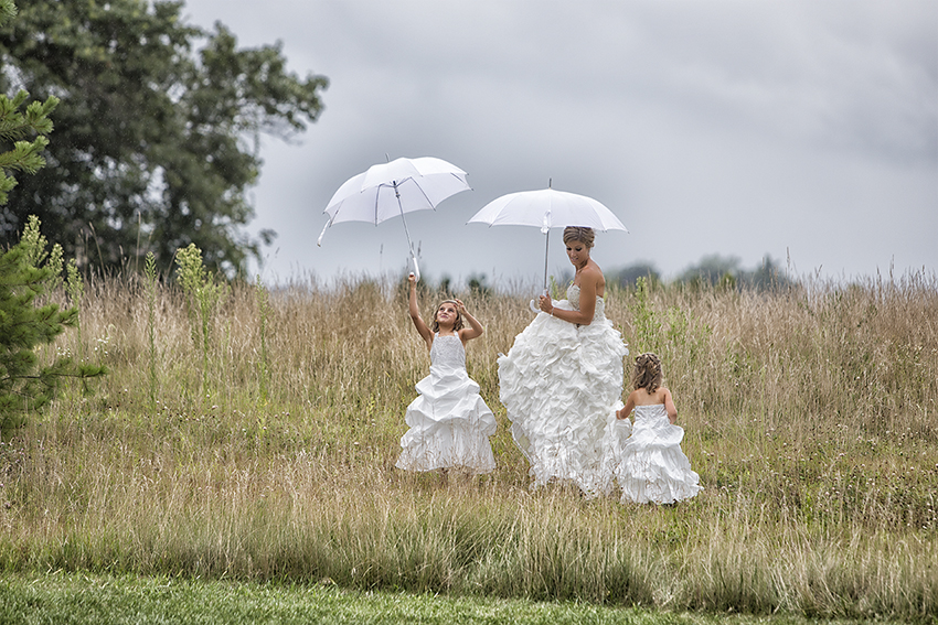 bride and flower girls in rain